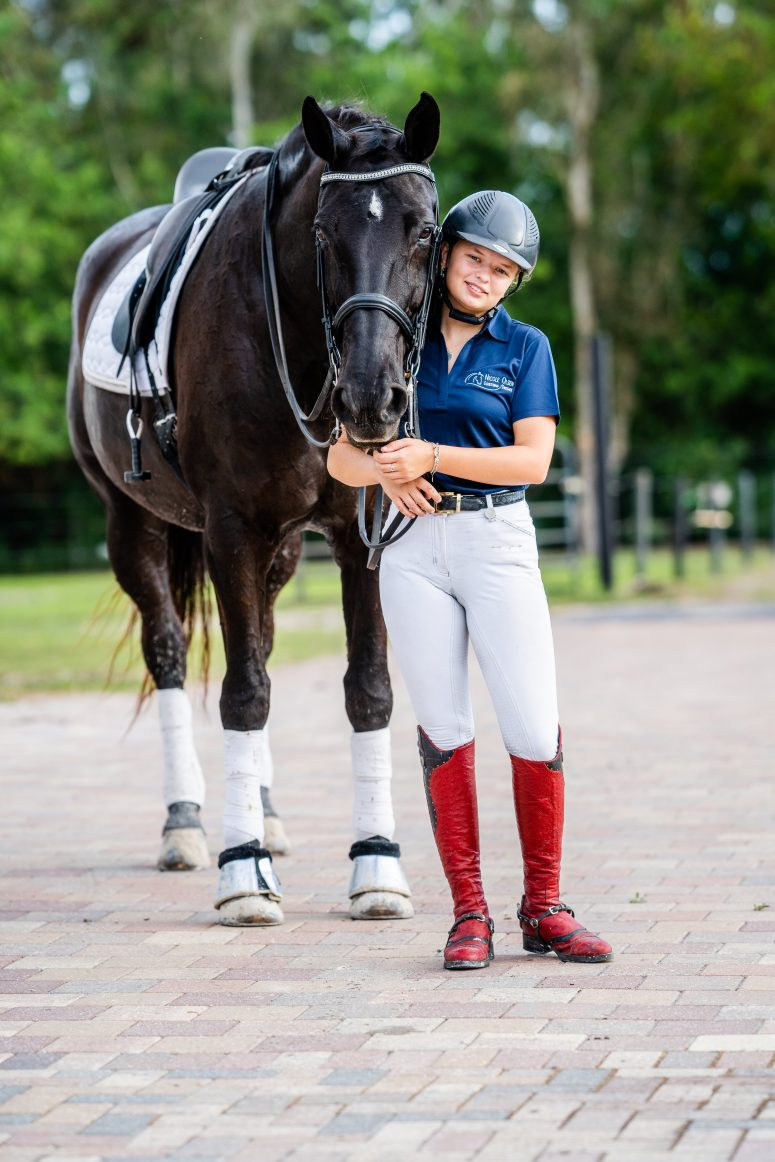 girl and black warmblood mare in florida