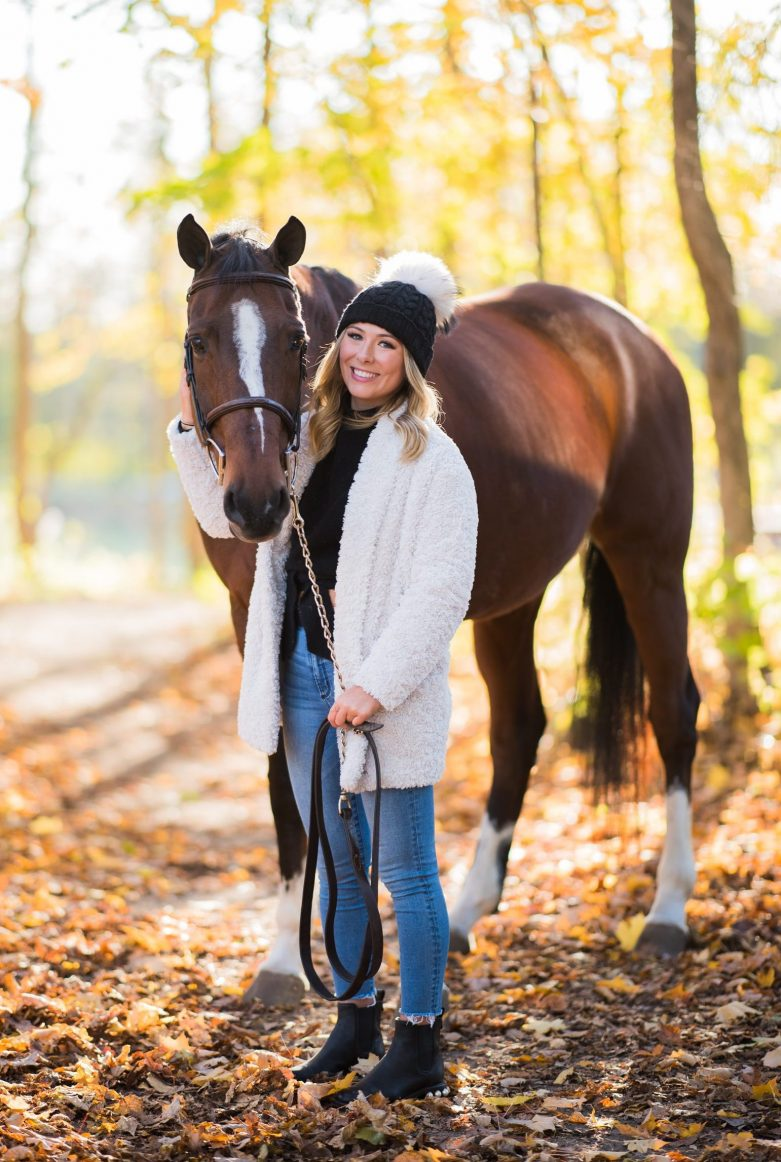 girl with toque and horse in the autumn
